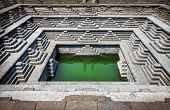 pic of karnataka  - Stepped tank with green water in Pushkarani Hampi Karnataka India - JPG