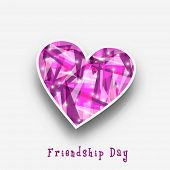 Shiny pink heart shape sticky on grey background for Happy Friendship Day celebrations.