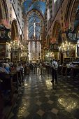 KRAKOW, POLAND - SEPTEMBER 15, 2013: People in the Church of Our Lady Assumed into Heaven, also know