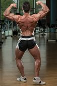 Bodybuilder Performing Rear Double Biceps Pose