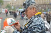 KIEV, UKRAINE - APR 19, 2014: Artist painting working helmets for tourists in the rioters camp. Puts