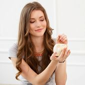 Cute, beautiful woman with moneybox