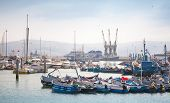 Tangier, Morocco - March 22, 2014: Fragment Of Tangier Port With Small Fishing Boats And Sailors At