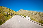 Asphalt road through the mountains of Gjirokaster region, southern Albania.