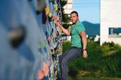 Young Man Climbing Wall Rock Outdoors