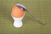 Egg in support and teaspoon