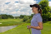 Female Golfer Looking At Copy Space