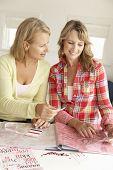 Mid age women scrapbooking