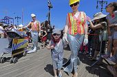 Little boy in construction garb with mom