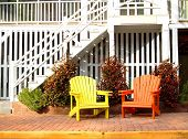 Beach House With Colorful Wooden Chairs