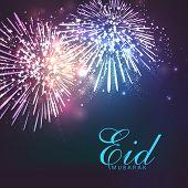 Shiny colorful fireworks in night background for muslim community festival Eid Mubarak celebrations.