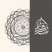 Arabic islamic calligraphy of text Eid Mubarak with stylish floral design on grey and beige background.