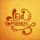 Stylish floral text Eid Mubarak on shiny golden background for Muslim community festival Eid Mubarak.