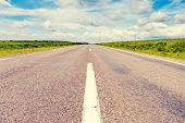 Empty asphalt road with cloudy blue sky. Ukraine, Europe. Beauty world.