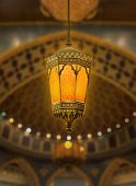An illuminated Ramadan lantern against islamic architecture