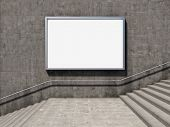 Blank advertising billboard on concrete wall with steps up