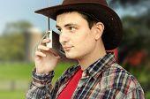 Cowboy Getting Forecast News On The Radio