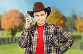 Farmer Posing With Portable Radio