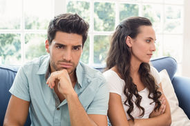 image of not talking  - Attractive couple not talking on the couch at home in living room - JPG