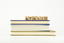 stock photo of dialect  - arabic word on wood stamps stack on books language and education concept - JPG