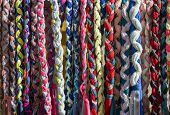 foto of adornment  - several hanging colorful fabric strings for adorn - JPG