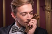 picture of tobacco leaf  - Selective focus on the handsome young fair - JPG