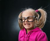 Scared little girl in funny big spectacles