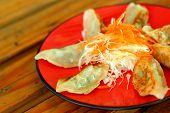 Fried Gyoza At Plate - Japanese Food.