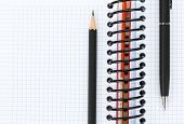 Blank notepad with pen and pencil. Closeup with copy space