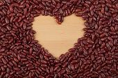 stock photo of kidney beans  - Red kidney beans with heart shape wooden copy space - JPG