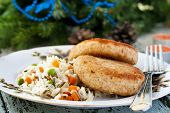 Fish cutlet with a side dish of rice
