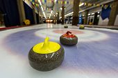 Curling Stones On An Indoor Rink
