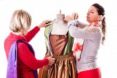 stock photo of dress mannequin  - two happy seamstresses working on a dress on a mannequin isolated over a white background - JPG