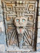 picture of cultural artifacts  - Ancient stone door with mask on it - JPG