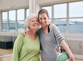 Senior Woman With Her Personal Trainer At Gym