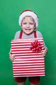 Little smiling Boy holding present box. Christmas concept