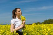 girl with yellow flowers on the field