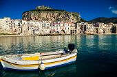 Old Boat Drifting In A Cefalu Harbor