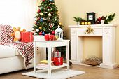 Beautiful Christmas interior with decorative fireplace and fir tree