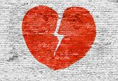 Broken Heart Painted On Brick Wall