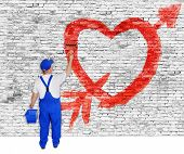 Heart And Arrow Painted On Brick Wall By Man
