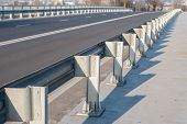 pic of safety barrier  - Anodized safety steel barrier on freeway bridge - JPG