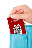 Hand Holding Christmas Coupon In Wallet Isolated Over White