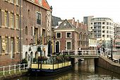Traditional dutch houses on the canal in Alkmaar town, Holland