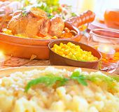 stock photo of centerpiece  - Festive dinner with baked chicken in centerpiece of table - JPG