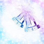Silver jingle bell border, Christmas tree ornament and holiday decoration isolated on blue and purple blurry background