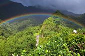 Tahiti. Polynesia. Clouds over a mountain landscape and rainbow