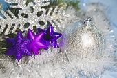 three decorative violet toys of a snowflake and silvery New Year's ball