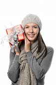 Pretty Woman In Winter Outfit Holding Present