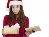 stock photo of sad christmas  - Caucasian christmas woman looking unhappy with her christmas gift - JPG